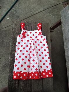 Cute girls dress, crisp white with red polka dots, knot ties. $39.00, via Etsy.