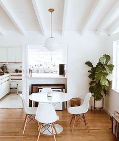 painted white beamed ceiling in dining room with pendant globe light. / sfgirlbybay