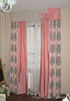 I'm not crazy about pink, but I love the bow embellished valance and two toned curtains for a girls room