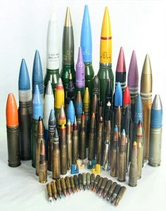 Ammunition collection featuring .50 BMG, 7.62x51mm NATO, 6mm SAW, and small-caliber cannon cartridges. Find our speedloader now! http://www.amazon.com/shops/raeind