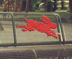 Cross stitch on a park bench
