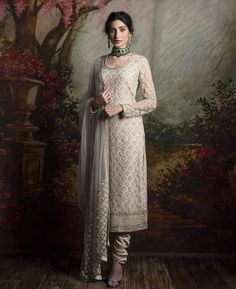 White suit paired with green emerald jewelleryBaby pink light anarkali with embroidered jacket and sequinned dupatta - Sabyasachi 2016