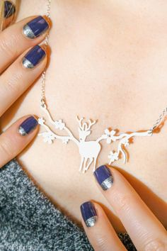 Deer Necklace by Shlomit Ofir and nail art in dark blue and silver half moon - on Blingfinger blog