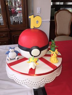 "Sophia is really into Pokemon these days and so for her 10th birthday we did a grand Pokemon themed party replete with Pokeball Chinese lanterns,  a pokeball tablecloth, a Pokeball cake and more to come.  This is the first post in the series I will refer to as ""Pokemon Insanity"" or &qu"