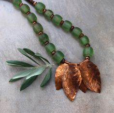 Huge Green Glass Bead Necklace Old Nepal Glowing Green Beads with Large Hammered Copper Leaves Rustic Autumn Necklace Etsy Handmade, Handmade Items, Old Bottles, Gifts For Nature Lovers, Hammered Copper, New Leaf, Beaded Necklace, Necklaces, Leather Cord
