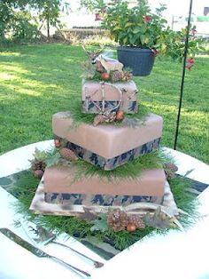 The redneck camo/hunting wedding cake ;) I would put pink ribbon around it