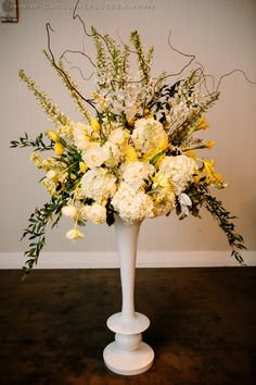 Yellow and White Aisle Arrangement by Flora Fetish. Photo by Caroline + Ben.