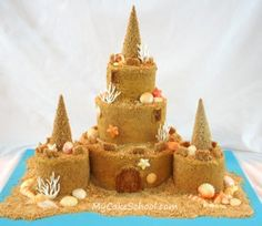 """For a Mermaid Party: Sand Castle Cake made with ice cream cones for towers, graham cracker """"sand"""" and chocolate sea shells. Link leads to site that you can join to see videos of how to make the cakes but you have to pay tuition to see tutorials, thus the name """"Cake School"""". Creating this masterpiece might be possible with a little imagination and looking at the photo."""