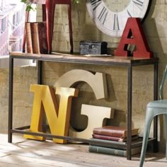 Grandin Road- Soho Console Table, add our own wood doors and make this storage for front entry?