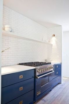 white subway tile kitchen with blue lacquer lower cabinets and brass hardware. white subway tile kitchen with blue lacquer lower cabinets and brass hardware. Kitchen Inspirations, New Kitchen, Blue Kitchens, White Kitchen, Home Kitchens, Home, Kitchen Design, Kitchen Renovation, Kitchen Dining Room