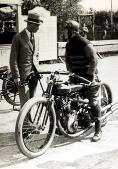 20 May 1922, HRH The Duke of York pictured at Brooklands race meeting with motor cyclist S.E. Wood.