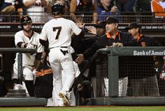 SAN FRANCISCO, CA - SEPTEMBER 25: Grego Blanco #7 of the San Francisco Giants is congratulated by manager Bruce Bochy #15 (R) after Blanco scored against the San Diego Padres in the bottom of the third inning at AT&T Park on September 25, 2014 in San Francisco, California. (Photo by Thearon W. Henderson/Getty Images)