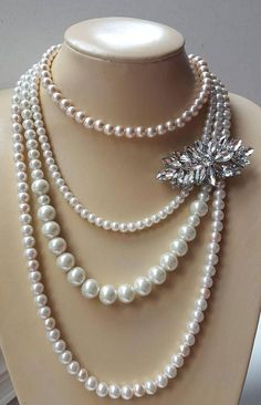 Check out this item in my Etsy shop https://www.etsy.com/ca/listing/531958634/multilayer-pearl-necklace-with-removable