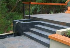 More ideas for decking going down a slope. Also, love the water feature!