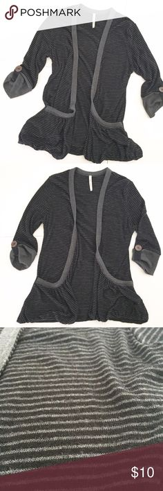 "🔴 Mi Ami Gray & Black Striped Stretchy Cardigan Mi Ami brand Cardigan! Black and gray striped with light gray trim. Has big flowy pockets on the front. 3/4 length sleeves with cute brown button. Open front. Size medium but runs small- please use measurements to ensure best fit: 23 1/2"" long, 15"" pit to pit, sleeves 11"" long. Has some wear/pilling/fuzz. 64% rayon, 32% polyester, 4% spandex. NO TRADES. Mi Ami Sweaters Cardigans"