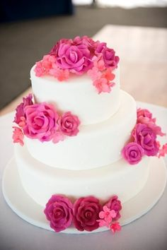 Pretty pink flowers on this gorgeous cake! {Marrero Weddings and Events} Follow @weddingwire for more inspiration!