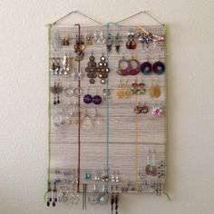 I turned this table mat into an earring holder. Cheap alternative to commercial jewelry boxes, and what a fun way to display your collection! Bought this table mat on sale at Ten Thousand Villages :)