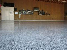 An epoxy floor in the garage both looks awesome and is more durable than regular concrete.