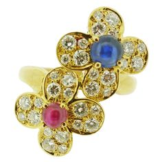 Van Cleef & Arpels Ruby Sapphire Diamond Gold Flower Cluster Ring | From a unique collection of vintage cluster rings at https://www.1stdibs.com/jewelry/rings/cluster-rings/