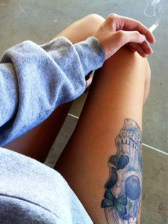 Thigh tattoo, Skull and butterfly