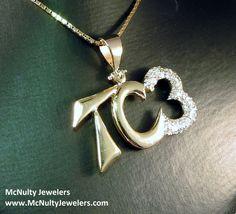 Hand made custom initials pendant. 14kt yellow gold and diamond accent.  McNulty Jewelers original design