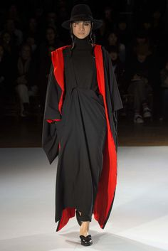 See the complete Yohji Yamamoto Fall 2015 Ready-to-Wear collection.