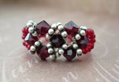 """Super easy ring to make. Video tutorial.Try using different types of beads and spacer beads to achieve different looks. Check on side bar for the """"Basic Technique"""" link if you don't know how to add the ring band. Don't forget to checkout the blue version."""