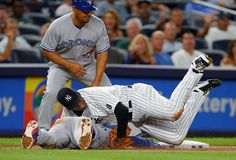 Full contact sport:    Pitcher Luis Severino of the New York Yankees rolls over Devon Travis of the Toronto Blue Jays after making the tag on a rundown play during the sixth inning Sept. 7 in New York. The Yankees won 2-0.