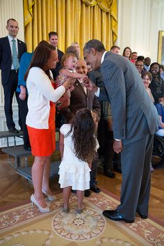 President Barack Obama greets wounded warriors and their families in the East Room during their tour of the White House, Aug. 25, 2014. (Official White House Photo by Pete Souza)