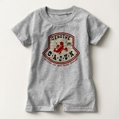 """Genuine Cajun Baby Romper This romper says """"Genuine Cajun, 100%, Laissez Les Bon Temps Rouler! printed on a wooden plaque with a dancing crawfish. Makes a great gift for any baby who's a real cajun, and proud of it!"""