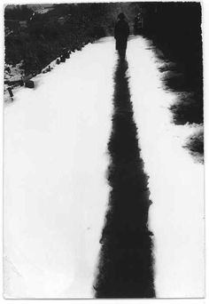 Masao Yamamoto>A metaphoric photo. The key elements are within our proximate reach: white and black. A white that is stained by black, a trail of human sins in a so called white and pure landscape.  What are we humans leave behind after we are gone ? I would say we leave behind lots of sins, frustrations, un-accomplishments, ambiguities. That is to say a black trail onto a white landscape.
