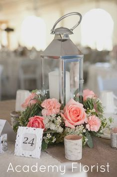 Love these garden party inspired #lantern #centrepieces by @Academy Sports + Outdoors Sports + Outdoors Florist