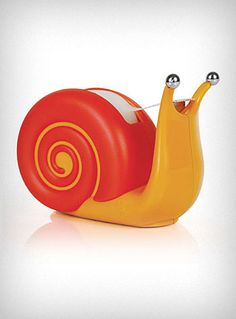 This adorable scotch tape dispenser is sure to put a smile on your face every time you use it. Made of molded plastic in shades of orange and red, the cute Japanese inspired snail is perfect for work or home ♥