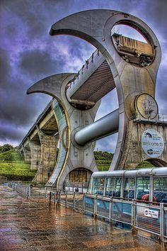 Falkirk Wheel - Scotland A rotating Boat Lift. I had to google this.