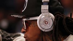 Lil Wayne wearing a million dollar Beats by Dre headphones.