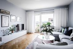 Light colored studio apartment, love the gallery wall around the TV. Are you looking for unique and beautiful art photo prints to create your own gallery wall? Visit bx3foto.etsy.com
