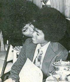 Diana Ross giving young Michael Jackson a kiss on his cheek.