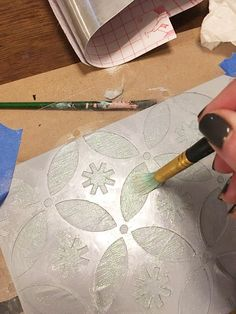 Learn how to make a DIY gift box from a Whitman Sampler box and the Holiday Cheer Craft stencil from Cutting Edge Stencils. http://www.cuttingedgestencils.com/christmas-stencils-designs-holiday-cheer.html