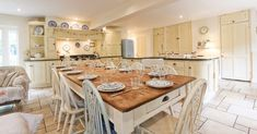 The large painted #kitchen at Gardeners Cottage in Blakeney is ideal for entertaining