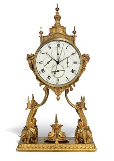A MAGNIFICENT GEORGE III ORMOLU STRIKING TABLE CLOCK FOR THE CHINESE MARKET, CIRCA 1790, IN THE MANNER OF WILLIAM CARPENTER, LONDON, LATER DIAL AND MOVEMENT - the drum case with urn finials and fruiting cornucopia to the sides, raised on a swept frame with Obelisks supported by four elephants, the rectangular plinth with addorsed dolphins supporting an Obelisk and simulated waterfall. Dim: 33 in. (81.2 cm.) high; 17 ¾ in. (45 cm.) wide; 11 ¼ in. (28.5 cm.) deep.