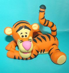 I make custom fondant cake toppers, inbox me for a quote :) This listing is for a fondant Tigger cake topper, about 4 inches across, Winnie the pooh is