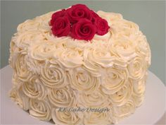 Buttercream piped rosettes topped with gum paste red roses