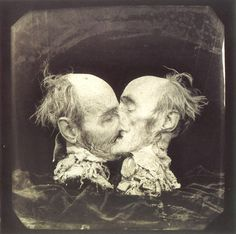 this man's head is cut in half to appear that he is kissing himself
