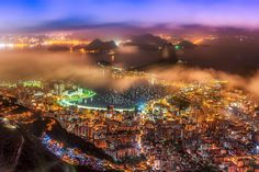 The Christ view - Picture taken from the Corcovado at 4am in Rio de Janeiro Brazil, right after this picture the fog completely cover the city.