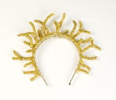 New golden crown by Tavia Sanza made with gold wire and large gold seed beads. Creates a halo around the head.
