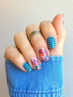 Your nails will stand out in this glossy mixed-mani featuring white stripes over a teal background coupled with a bold flower pattern. #nails #mani #diynails #diynailart #nailart #manicure #floralnails