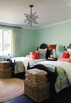 Gorgeous little guest room. The black twin beds make such a statement (but would look great stained a deep wood, as well), the color combo of aqua on the walls and linens goes PERFECTLY with that poppy red. And y'all KNOW I love that Moravian star pendant ;) ~Ash @Formerly LFF Designs  www.facebook.com/LFFdesigns
