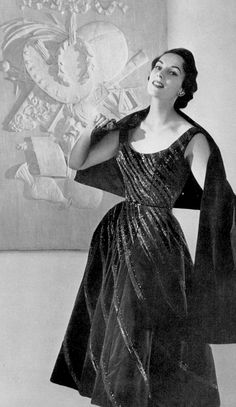 Susanne Erichsen in blue silk velvet short evening dress decorated with fine glitter embroidery of the same tone by Jean Patou, photo by Georges Saad, 1954
