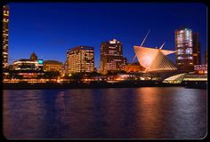 WISCONSIN ~ This is the Milwaukee Lakefront at night. The 'weird shaped' building is the new Milwaukee Museum. Milwaukee Lakefront, Milwaukee Skyline, Milwaukee City, Milwaukee Wisconsin, Visit Milwaukee, Places To See, Places Ive Been, School Murals, 100 Things To Do
