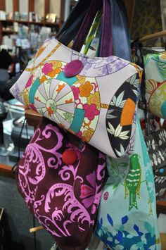 Becky O'Neil  http://www.beckyoh.com  Becky is the creator of the Becky Oh! line of custom handbags, each purse is a one of a kind creation, using a wonderful assortment of fabrics. Becky lives in Manchester, NH and sells her bags not only in the United States, but as far as Japan and Mexico. The bags, which are for sale in the Currier Museum of Art's Museum Shop, Manchester, NH, range from $25-$95.
